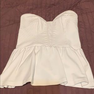 A simple white peplum shirt